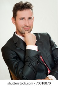 Young businessman,  in  the suit