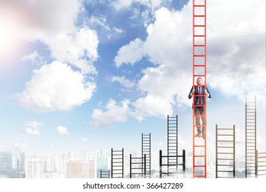 A young businessman in a suit climbing a red ladder, many other ladders behind, city view and blue sky at the background. Concept of career development.