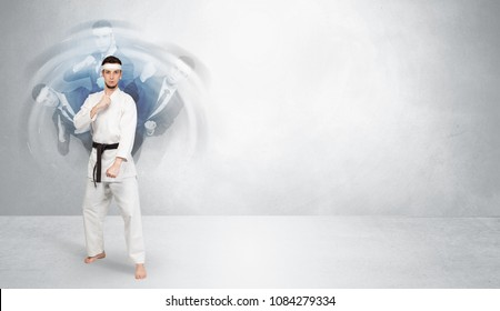 Young businessman in suit fighting with empty wall background