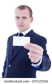 young businessman in suit holding business card isolated on white background. focus on hand