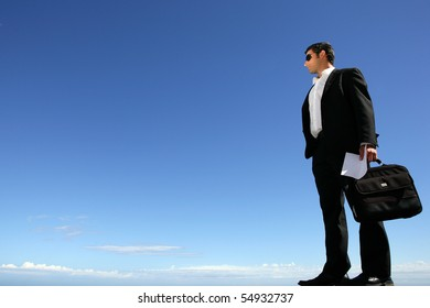 Young businessman in suit with sunglasses