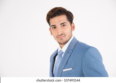 young businessman in suite on white background