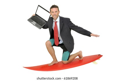 Young businessman with surf board and laptop