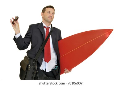 Young businessman with surf board recieving a call from the office