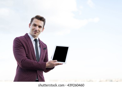 young businessman with the tablet in a jacket