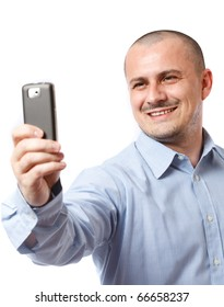Young businessman taking photos with his cellphone