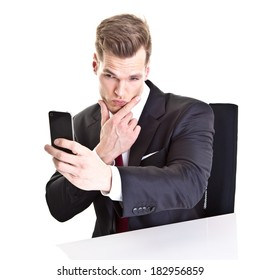 Young businessman taking a selfie with his smartphone - isolated on white