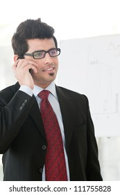 young businessman talking on the cell phone