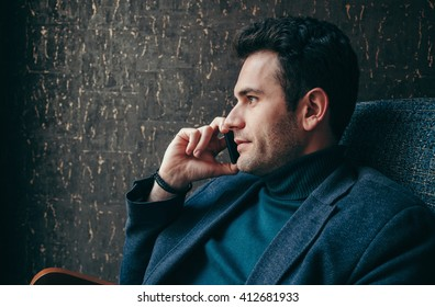 Young businessman talking on smart phone