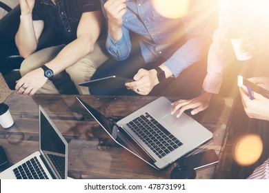 Young Businessman Team Analyze Finance Online Report Modern Electronic Gadgets.Coworkers Startup Digital Project.Creative People Making Great Work Decisions.Tablet Hands Laptop Table.Closeup Flares