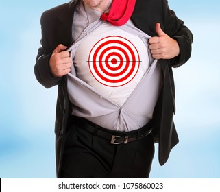 Young businessman tearing his shirt -bullseye symbol on it