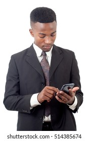 young businessman texting on cellphone suit and tie