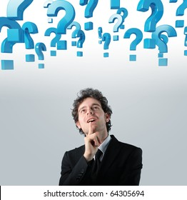 young businessman thinking and 3d question mark background