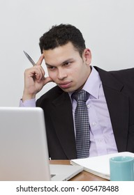 Young businessman thinking about business plan