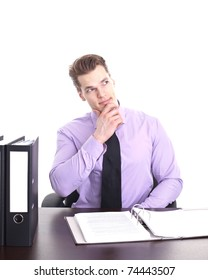 Young businessman thinking with hand on chin, isolated over white background