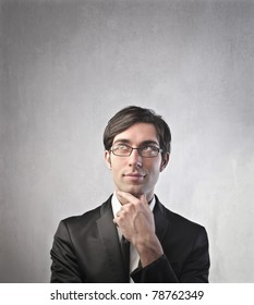 Young businessman with thoughtful expression