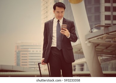 Young businessman in a urban setting and Portrait of happy businessman with arms crossed standing Outside