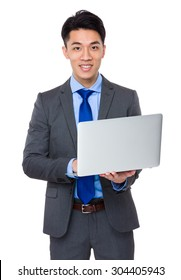 Young Businessman use of the notebook computer