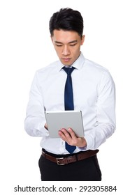 Young businessman use of tablet pc