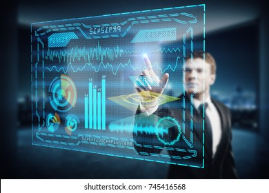 Young businessman using digital business hologram in blurry office interior with night city view. Touchscreen concept. Double exposure