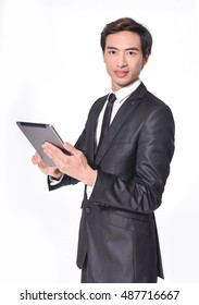 Young Businessman Using Digital Tablet â??white background