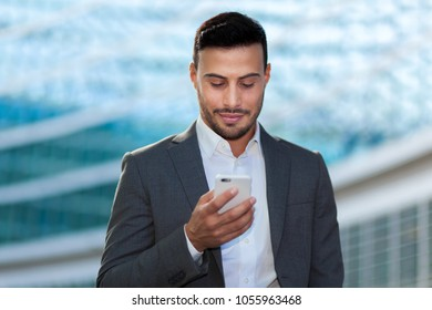 Young businessman using his smartphone