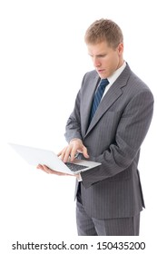 young businessman using laptop on white background