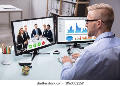 Young Businessman Video Conferencing With His Colleague On Computer