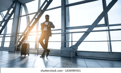 Young Businessman Waiting for Flight, Standing in Airport Terminal, Free Space