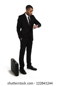 Young businessman waiting for someone over white background