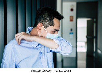 A young businessman wearing mask a face prevent the spread of the Covid-19 virus  while coughing, sneezing in office.