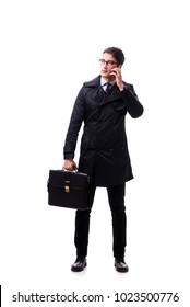 Young businessman wearing winter coat isolated on white