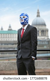 Young businessman wearing wrestling mask against St. Paul's Cathedral