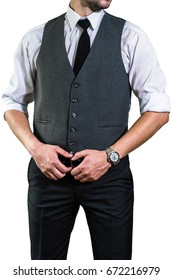 A young businessman in a white shirt with a tie is holding his hands on his belt. A guy, a hipster in a gray waistcoat and a shirt with a rolled up sleeve. Ready for work