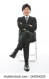 young businessman who sits down on a chair