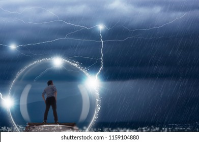 Young businessman within protection from bad weather and thunderstorm, Businessman protected in case of any trouble.