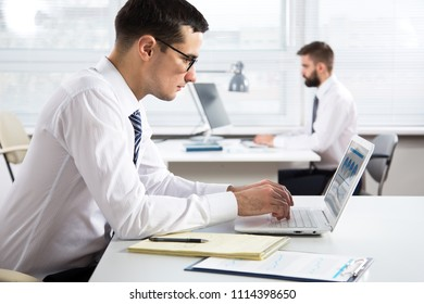 Young businessman working with computer in an office