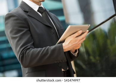 Young businessman working with digital tablet