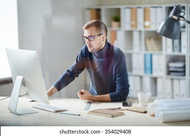 Young businessman working in front of computer in office