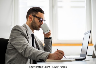 Young businessman is working in office.