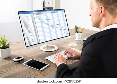 Young Businessman Working On Gantt Chart On Computer At Office