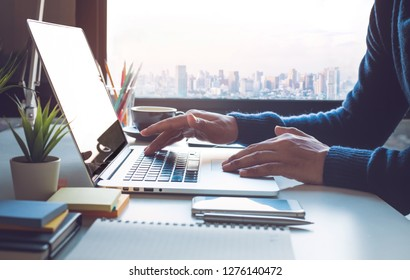 Young businessman working on laptop in office with window city view.Business strategic planning.study learning,blogger and freelance concepts ideas - Image
