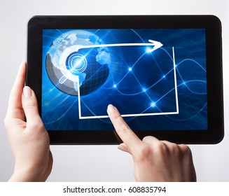 Young businessman working on the tablet select on the virtual display. Business Technology Internet and network concept.