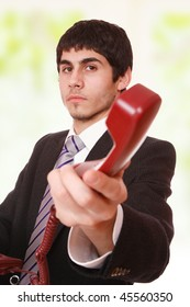 Young businessman working with phone at work
