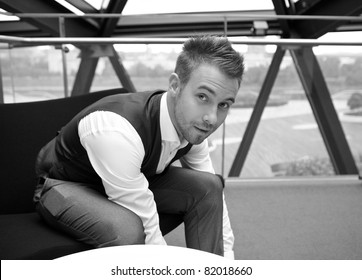 The young businessman in the workplace. Black-white photo.