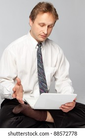 Young businessman yoga before an open notebook