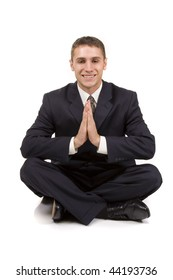 Young businessman in yoga position