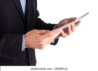 Young businessman's hands working on a tablet pc comuter isolated on white