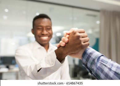 Young businessmans are shaking hands after meeting