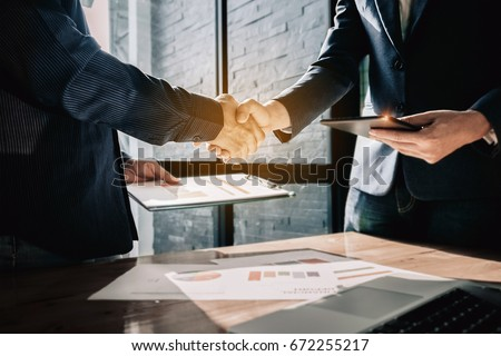 Young businessmen collaborate with partners to increase their business investment network for  Plans to improve quality next month in their office. agreement concept.